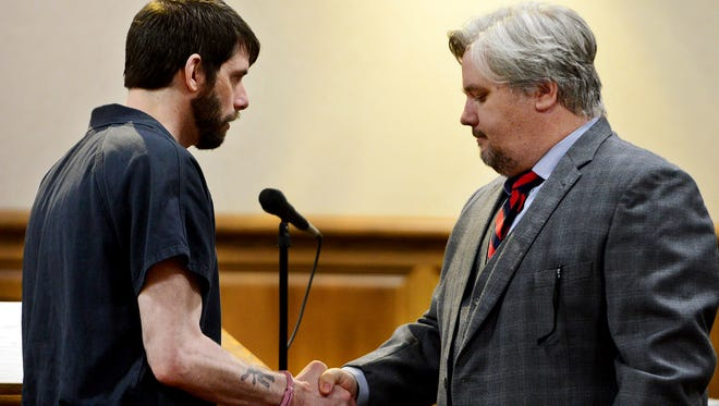 John Christie shakes hands with his attorney Brandon Newman after a hearing in this October file photo.
