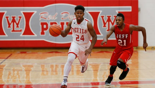 West Lafayette's Nai Carlisle is marked by David Hanyard of Lafayette Jeff as he brings the ball up court Wednesday, February 10, 2016, at West Lafayette High School. Jeff defeated West Lafayette 65-54.