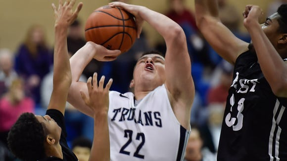 Chambersburg's Cade Whitfield splits a pair of defenders during the Trojans' play-in game against Central Dauphin East on Friday. Chambersburg ended its season with a loss.