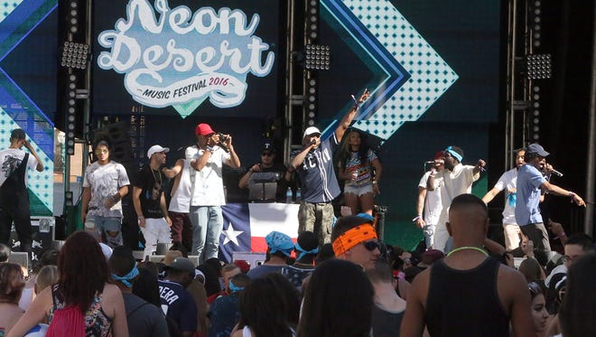 The combined group called New Paso performs on the Rio Bravo Stage at the 2016 Neon Desert Music Festival on Saturday in Downtown. The group was a collection of several rap artists performing together. The festival, consisting of three main stages, continues Sunday. See more photos on Page 3B and at elpasotimes.com.