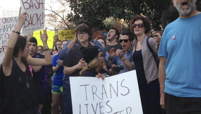 People protest outside the North Carolina Executive Mansion in Raleigh, N.C., Thursday, March 24, 2016. North Carolina Gov. Pat McCrory signed legislation that prevents cities and counties from passing their own anti-gay, lesbian and transgender regulations.
