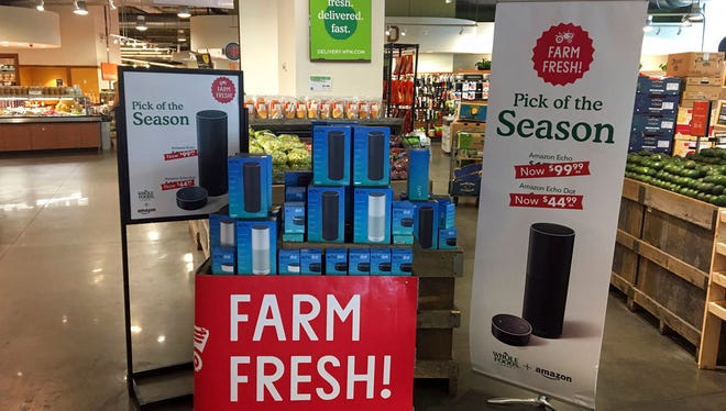 In this Monday, Aug. 28, 2017, file photo, Amazon's Echo and Echo Dot appear on sale at a Whole Foods Market in New York.
