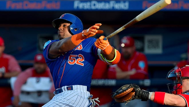 Mar 22, 2018; Port St. Lucie, FL, USA; New York Mets left fielder Yoenis Cespedes (52) connects for a double during a spring training game against the Washington Nationals at First Data Field.