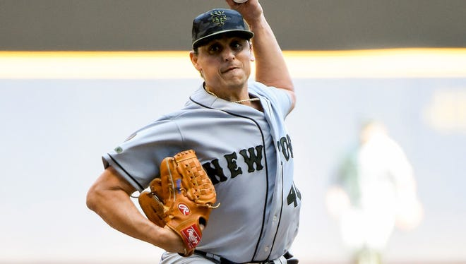 17 of 90020180526_jrs_bs5_090­.JPG May 26, 2018; Milwaukee, WI, USA; New York Mets pitcher Jason Vargas (40) throws a pitch in the first inning against the Milwaukee Brewers at Miller Park.