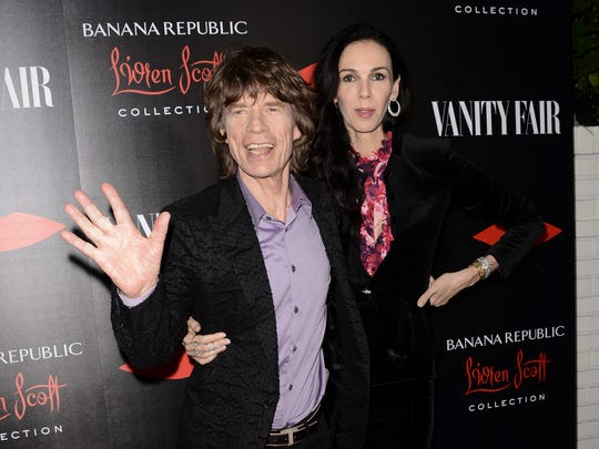 Singer Mick Jagger, left, and fashion designer L'Wren Scott arrive at the Banana Republic L'Wren Scott Collection launch party at the Chateau Marmont on Tuesday, Nov. 19, 2013 in West Hollywood, Calif. (Photo by Dan Steinberg/Invision/AP)