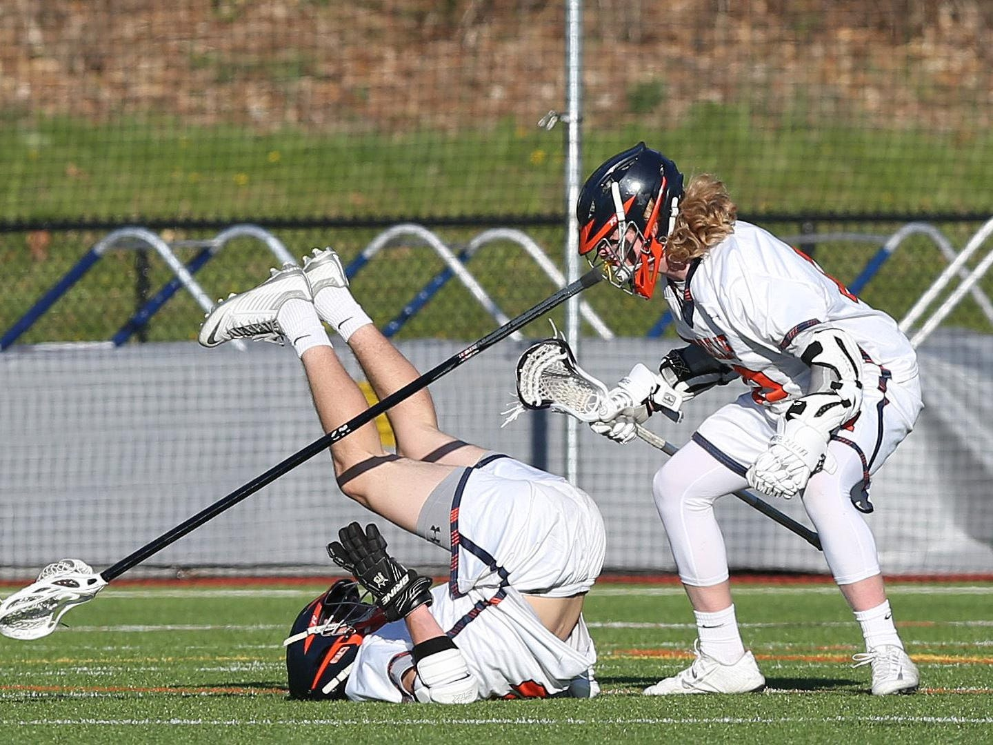 From left, Briracliff's Michael DeGasperis (2) falls backwards in front of teammate Peter Olson (17) as he releases a shot that ended up being the game winning goal in the 4th quarter against Pleasantville during a lacrosse game at Briarcliff High School April 20, 2016. Briarcliff won the game 8-7.