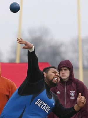Anthony Ray, Batavia, hurls the shot on his second third throw in the shot put at the 40th Annual His and Her Invitational track meet at Penfield High School Saturday, April 28, 2018.
