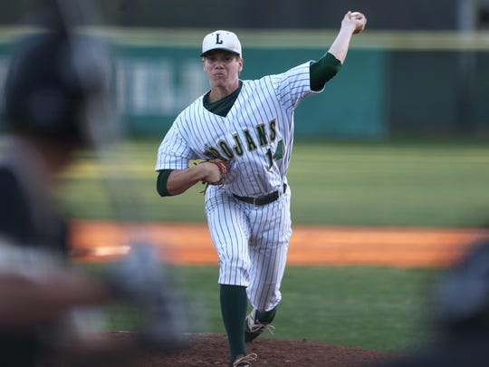 Lincoln senior Austin Pollock, an FSU signee, pitches Friday in a win over Gainesville Buchholz.
