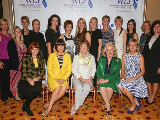 All of the participants in the Women Leaders Forum event are shown in a group photo which includes the honorees, presenters, event organizers and the 10 young women who were announced as scholarship winners.