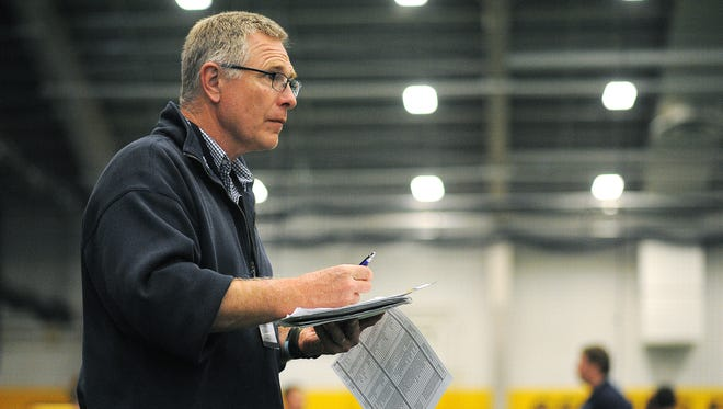 SDSU head football coach John Stiegelmeier looks on during the Sanford POWER Riggs Premier Football Academy 2015 Recruiting Combine on Saturday, May 9, 2015, at the Sanford Fieldhouse in Sioux Falls. College football coaches from schools in South Dakota, Minnesota, Iowa, North Dakota and Nebraska attended the event.