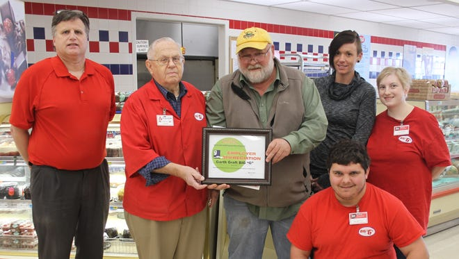 A special certificate of appreciation from Goodwill of the Heartland was presented to Big G Foods last week for their work with people with special needs. Kneeling in front is Dustin Landuyt. Back (l-r) are Gary Grafft and Garth Grafft, representing Big G Foods; Mark Jensen and Jamie Beauregard, Goodwill of the Heartland; and Susan Nevers.