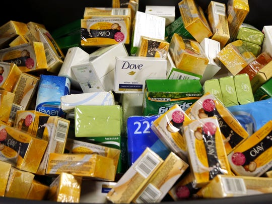 Boxes of soap await sacks in Stacy Wiener's home.