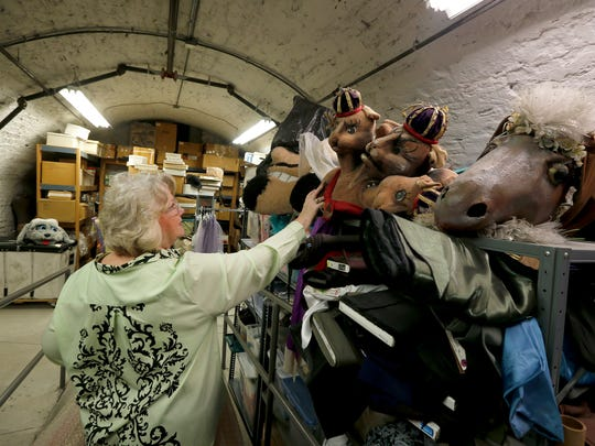 Diana Vandergriff-Adams, costume mistress at the Cincinnati Ballet looks at old costumes from  the Nutcracker in the storage area of the ballet's studios in Over-the-Rhine that was once a brewery. Vandergriff-Adams has worked for the Cincinnati Ballet for 43 years. Photo shot Thursday February 4, 2016
