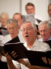 Voices of Naples member Paul Guehler rehearses at the Naples United Church of Christ.