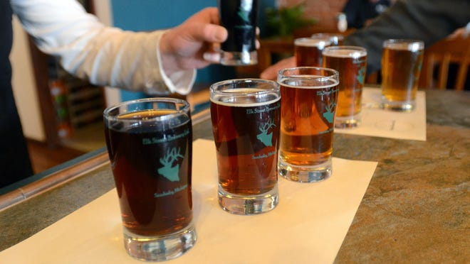 The eight different beers that are brewed on site are set up for a beer flight at the Elk Street Brewery & Tap Room in Sandusky.