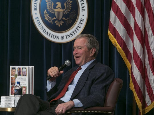 """George W. Bush discusses his new book, """"Portraits of Courage: A Commander in Chief's Tribute to America's Warriors,"""" in March at the Ronald Reagan Presidential Library in Simi Valley, Calif. Bush will sign copies of the book next week at the Vero Beach Book Center."""