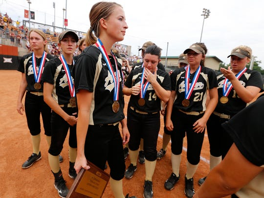Archer City's Eliot Hilbers, center, holds the third-place trophy after falling to Bells 3-1 during a Class 2A UIL State semifinal at McCombs Field in Austin, Wednesday.