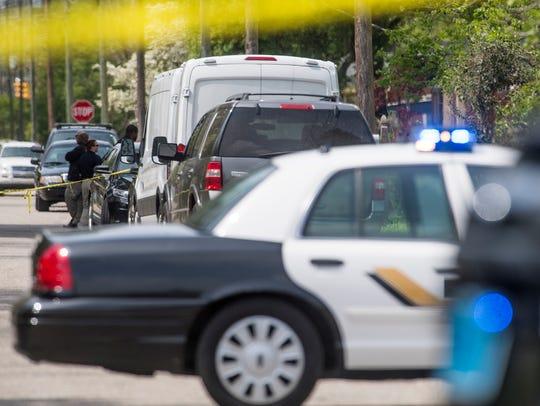 Investigators work the scene of a Montgomery Police