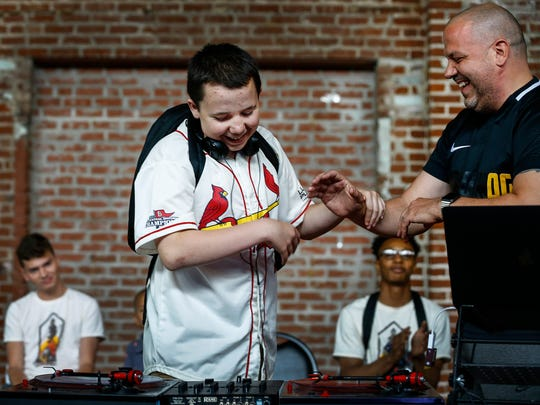 Camper Cooper Guidry (left) is congratulated by professional DJ Devin Steel after performing his showcase track to family and friends during Camp DJ Memphis.