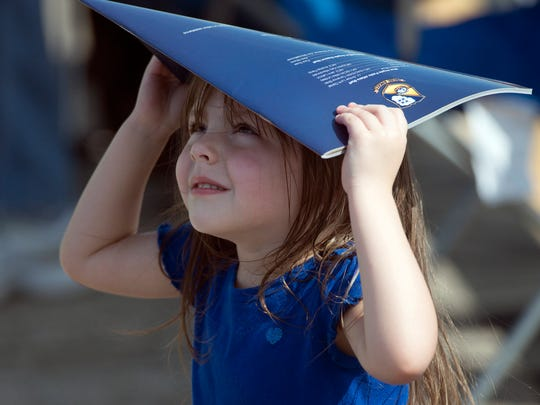 4-year-old Ashlyn Derrick makes her own shade while enjoying the 2015 Blue Angels homecoming air show Friday afternoon at Pensacola Naval Air Station.