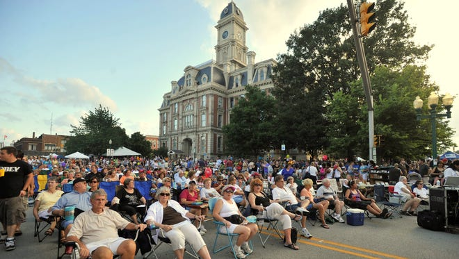 A large crowd sits in the shade of the historic Hamilton County Courthouse and listens to The Wright Brothers perform during the19th annual Noblesville Street Dance on the courthouse square Saturday July 24, 2010.