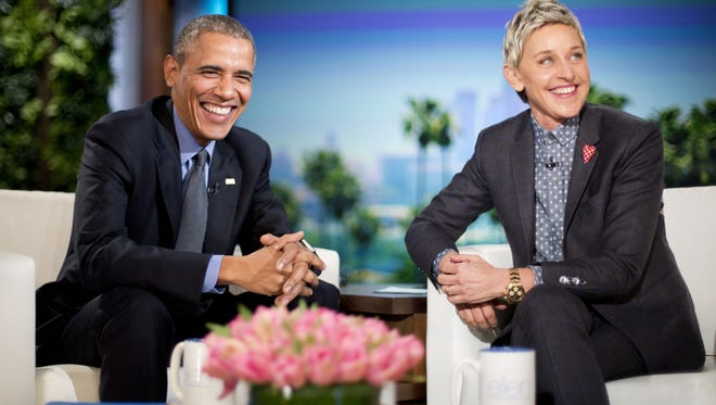 President Barack Obama talks with Ellen DeGeneres during a commercial break while taping a show segment of the Ellen DeGeneres Show in Burbank, Calif., Thursday, Feb. 11, 2016.