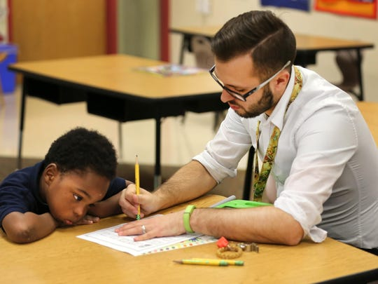 Kindergartner Montayo Turner-Ford works on his letters with teacher Brandon Fremming at Ethel M. Taylor Academy, a CPS school in Millvale. All of the CPS schools will soon be tested for lead in their drinking water.
