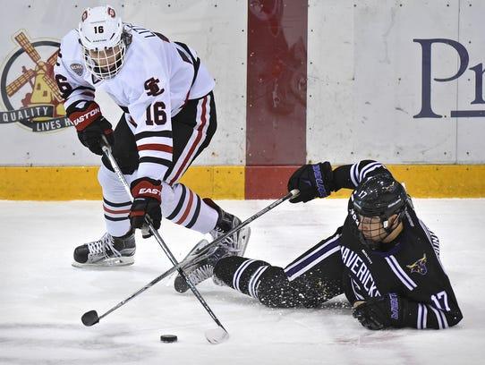St. Cloud State's Jon Lizotte (16) gets past Minnesota