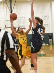 Pascack Valley #10 Toriana Tabasco drives to the basket  Girls basketball game between Pascack Valley and IHA in the championship game of the Joe Poli Holiday Tournament