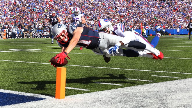 Julian Edelman dives into the end zone as he is tackled by the Bills' Aaron Williams, who was injured on the play.