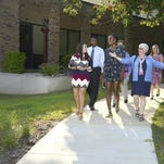 Venus Williams, center front, tours Indiana University East. With Williams are, from left, Alexis Hall, Vasha Davis, Tony Breitenbach, Chancellor Kathryn Cruz-Uribe and Lori Current.