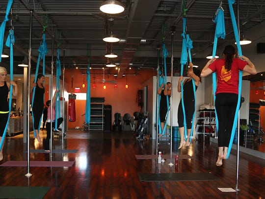 Getting comfortable standing in the fabric at introductory aerial classes at Kees Camp Saturday, Sept. 13, 2014.