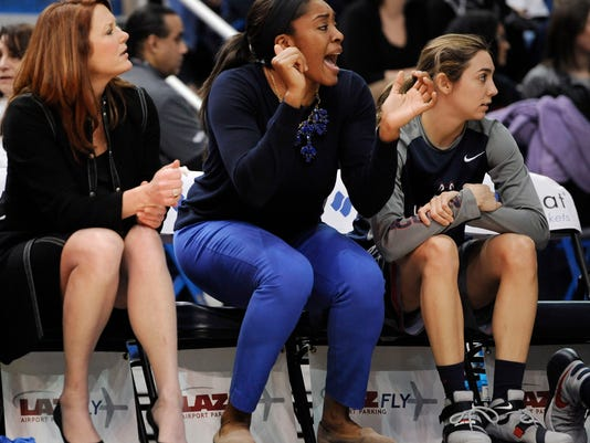 Connecticut's Moriah Jefferson cheers on the bench for her team during the first half of an NCAA college basketball game against UCF, Wednesday, Jan. 20, 2016, in Hartford, Conn. The UConn starting forward is resting her knee and will miss up to two weeks. (AP Photo/Jessica Hill)