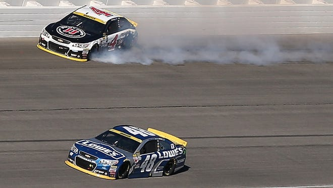 Kevin Harvick hits the wall after contact with Jimmie Johnson (below) during a restart left Harvick with a flat tire.
