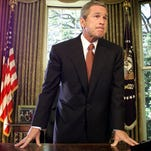 His emotions unhidden, President Bush finishes his remarks to reporters in the Oval Office at the White House in Washington, after speaking, Thursday, Sept. 13, 2001, on the phone with New York City Mayor Rudy Giuliani about Tuesday's terrorist attacks. During the conversation with Giuliani Bush said he will travel to New York Friday to offer his help in sustaining the recovery from the worst terrorist attack in United States history. (AP Photo/Doug Mills)