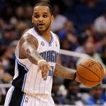 Dec 27, 2013; Orlando, FL, USA; Orlando Magic point guard Jameer Nelson (14) dribbles the ball and calls a play against the Detroit Pistons during the second half at Amway Center. Orlando Magic defeated the Detroit Pistons 109-92. Mandatory Credit: Kim Klement-USA TODAY Sports