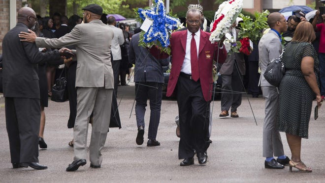 Mourners arrive at W.O.R.D. Ministries Christian Center in Summerville, S.C., on April 11. Dozens of mourners gathered Saturday for the funeral of Walter Scott, an unarmed black suspect who was shot dead by a white officer in South Carolina as he fled following a traffic stop.