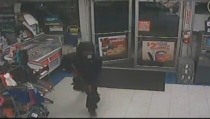 State police released a surveillance photo of the person who robbed a Canterbury-area convenience store early Monday.
