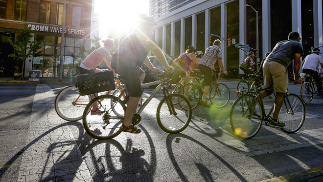 Cyclists ride through downtown Indianapolis at Bike Party Indianapolis on Friday, June 9, 2017. The group meets every second Friday of every month.