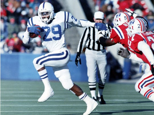Indianapolis Colts running back Eric Dickerson rushes against the New England Patriots in 1994.