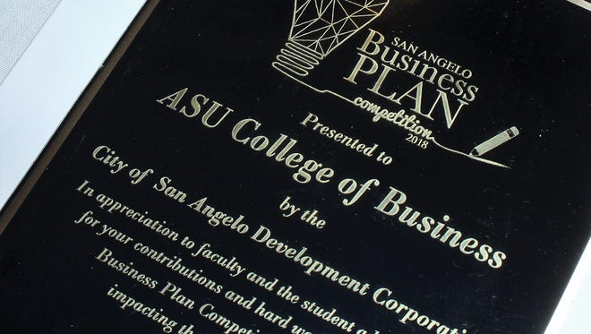 The ASU College of Business was presented a plaque for its role in assisting competitors in the 2018 Business Plan Competition. Twelve students, both graduate and upper-level undergrad, helped competitors draft their plans.