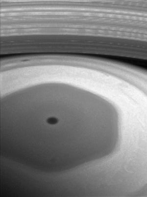 A strange hexagon-shaped storm spins over the northern hemisphere of Saturn.