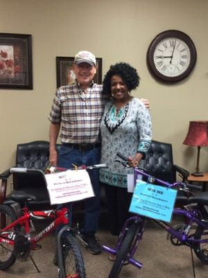Local UMWA 1740 retirees donated bicycles for each grade at Uniontown Elementary School for perfect attendance for the 2017-18 school year. The bikes will be awarded in May. Pictured are Bill Butler, left, and Mrs. Tamala Howard, principal of UES.