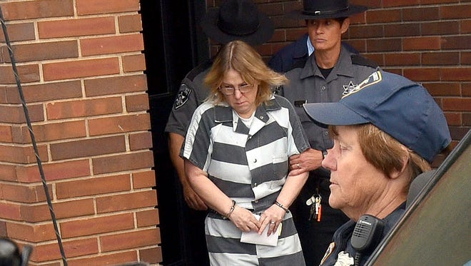 Joyce Mitchell leaves Clinton County Court after being sentenced Monday.