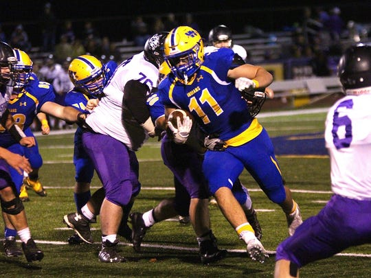Waynesboro's Forrest Rhyne bullies his way downfield during a football game against Mifflin County on Friday, Nov. 4, 2016. The Indians won, 35-5.