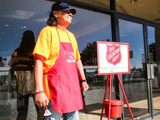 """I love the people and I love my community,"" Michael Sarabia said Wednesday as he rang a bell for the Salvation Army's Red Kettle Campaign outside of Sunset Mall. Sarabia has been a bell-ringer for seven years."