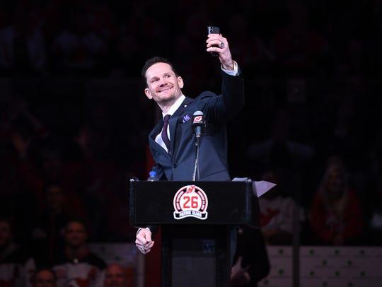 Patrik Elias takes a selfie during his jersey retirement