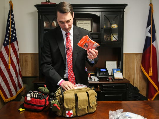 David Walker, Christoval superintendent, looks through a first aide kit Monday, Feb. 26, 2018, at his office. His staff is trained in first aide as well as tactical training as part of the guardian program.