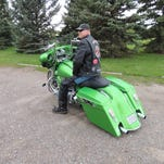 """Ted Nesmith's 2013 Harley-Davidson Street Glide license plate reads """"FST & LD"""" — fast and loud. When he bought it in 2013 at Big Sky Harley-Davidson, it looked completely different."""