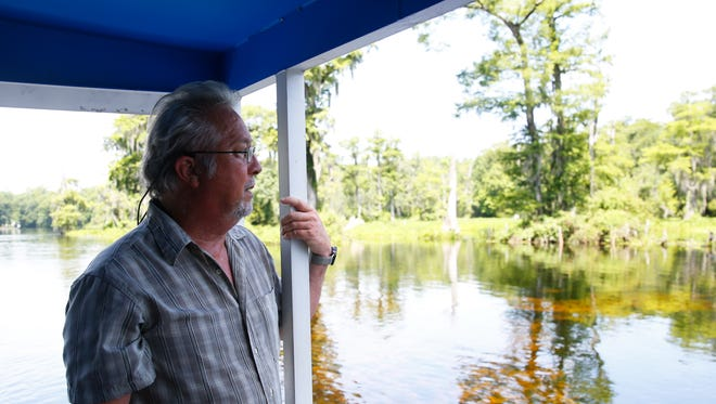 Dr. Sean E. McGlynn, director of the Wakulla Springs Alliance and McGlynn Laboratories Inc., observes various areas of the Wakulla Rivers during a boat tour on Monday.